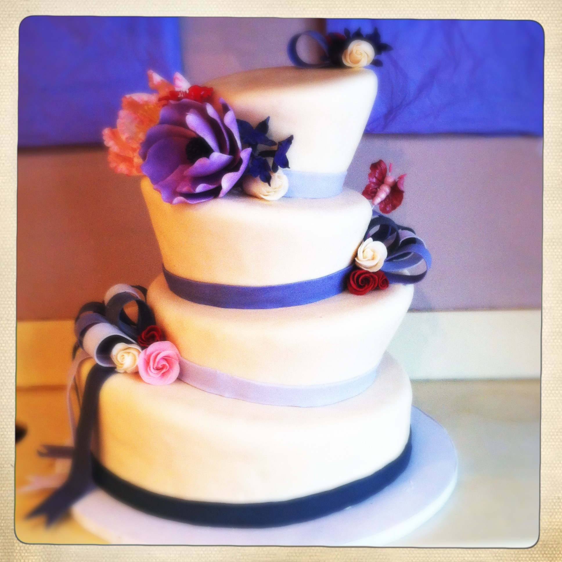 http://tiffanymacisaacdotcom.files.wordpress.com/2012/06/topsy-turvy-wedding-cake2.jpg